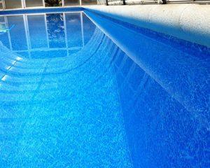 marmol azul piscina fondo semicircular